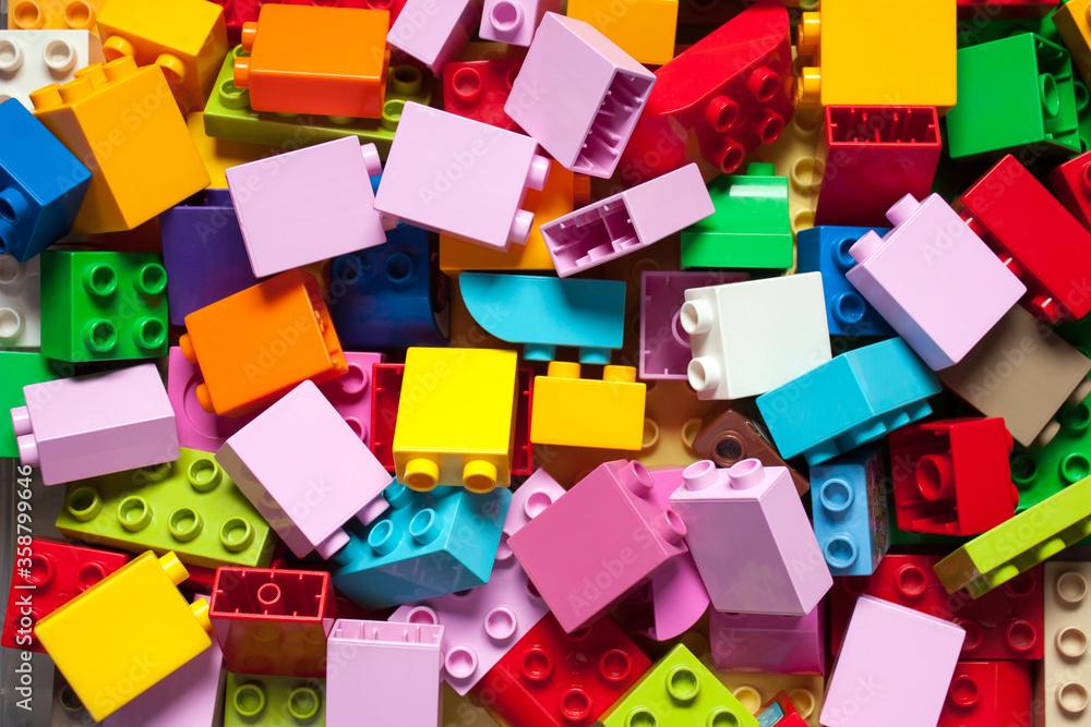 Fototapeta Pile of child's building blocks in multiple colours