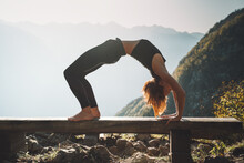 Yoga On Nature. Young Woman Is...