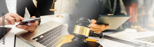 Fototapeta Business and lawyers discussing contract papers with brass scale on desk in office. Law, legal services, advice, justice and law concept . obraz