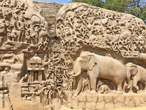 Fotografie, Obraz Descent of the ganges: A giant open air rock cut bas relief sculptures carved on two monolithic rocks in Mahabalipuram, Tamil nadu