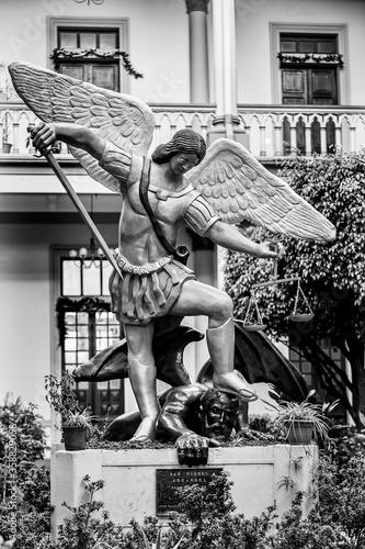 Photo It's Angel against devil Statue in San Salvador, El Salvador
