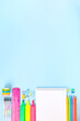 Various school office supplies on blue background. Back to school concept. Top view. Copy space