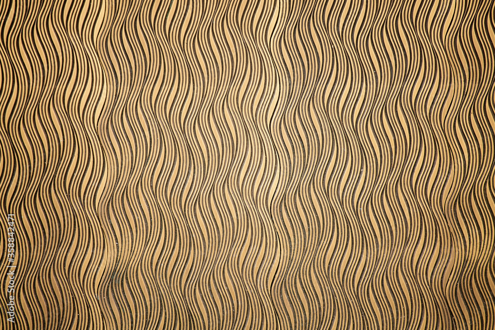 Abstract wavy pattern. Undulating golden ornament texture or background. Elegant wood carving embossing.