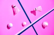 Leinwandbild Motiv Badminton shuttlecocks with tennis, baseball and golf balls on pink surface