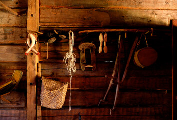 Old wooden spoons and farm tools, equipment in Finland, household objects