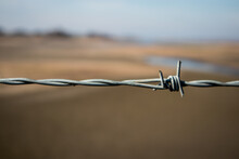 Sharp Barbed Wire Fence Border