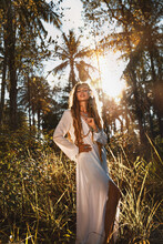 Beautiful Young Stylish Woman In White Dress On The Field At Sunset