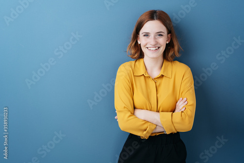Fototapety, obrazy: Pretty young woman with folded arms