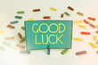 Word writing text Good Luck. Business photo showcasing expressing hope for someone to be successful with their circumstances Colored clothespin papers empty reminder white floor background office