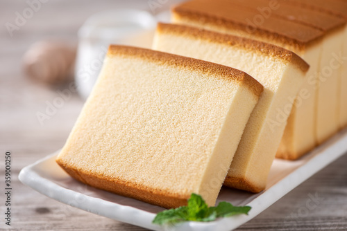 Castella - Delicious Japanese sliced sponge cake food on white plate over rustic wooden table, close up, healthy eating, copy space design Canvas Print
