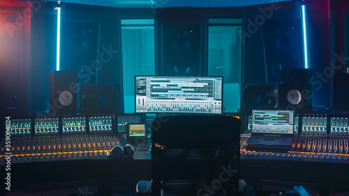 Fotografiet Shot of a Modern Music Record Studio Control Desk with Computer Screen show User Interface of DAW Software with Song Playing