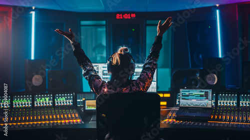 Artist, Musician, Audio Engineer, Producer in Music Record Studio, Uses Control Desk with Computer Screen showing Software UI with Song Playing Canvas Print