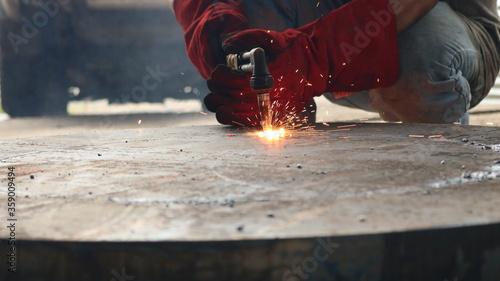 Fotografie, Obraz worker melting welding metal industry oxyacetilene