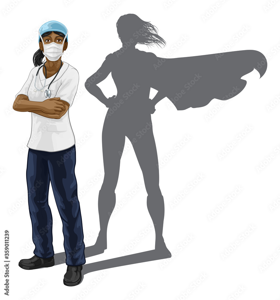 Fototapeta A nurse or doctor super hero woman in surgical or hospital scrubs with stethoscope and mask PPE. With arms folded and serious but caring look. Revealed as a superhero by the shape of her shadow.