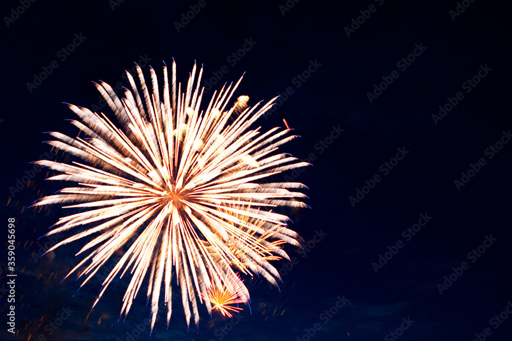 Fototapeta 4th July fireworks. Fireworks display on dark sky background
