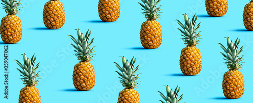 Many pineapples on a solid color background Fototapeta