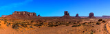 A panorama view showing Elephant Butte, East and West Mitten Buttes in Monument Valley tribal park in springtime