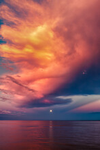 Moon Over Sea Horizon With Gol...