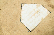 Home Plate Covered With Some D...