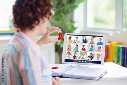 Obraz na plátně Online remote learning. Teacher with computer.