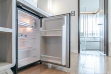Opened Small Refrigerator Unde...