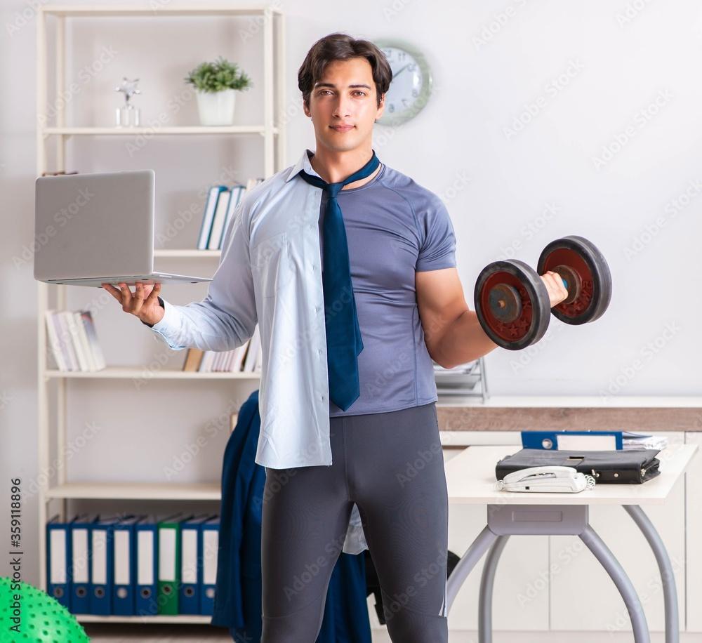 Fototapeta Employee combining work and healthy lifestyle