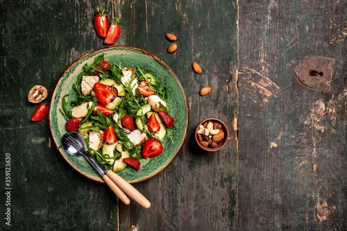 Fresh strawberry salad with arugula, chicken, avocado and strawberries Wallpaper Mural