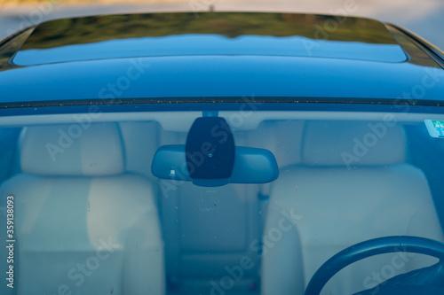 Fototapeta Windshield rain and light sensors position, luxury car windscreen, blue tinted glass, front view, technology design