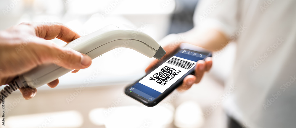 Fototapeta Using Mobile Phone To Scan Payment Code