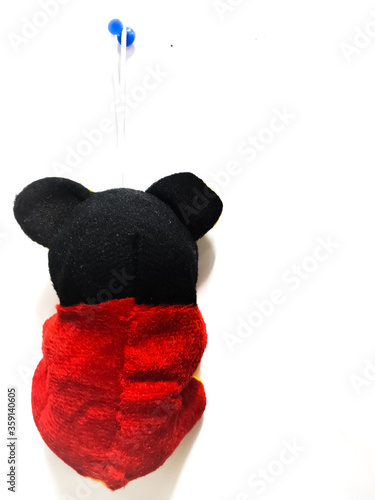 Photo Chennai, India - March 11th 2020 : Mickey mouse toy hanging backside on wall isolated on white background