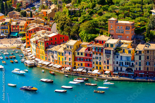 Fototapety, obrazy: It's Aerial view of Portofino, an Italian fishing village, Genoa province, Italy. A vacation resort with a picturesque harbour and with celebrity and artistic visitors.