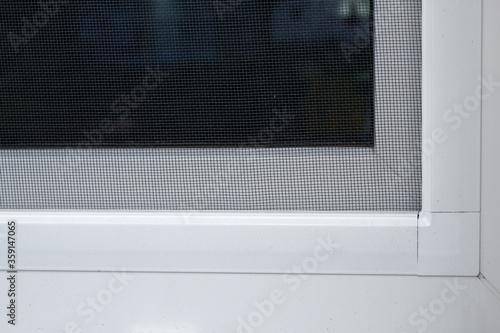 Fototapeta plastic window with mosquito net obraz