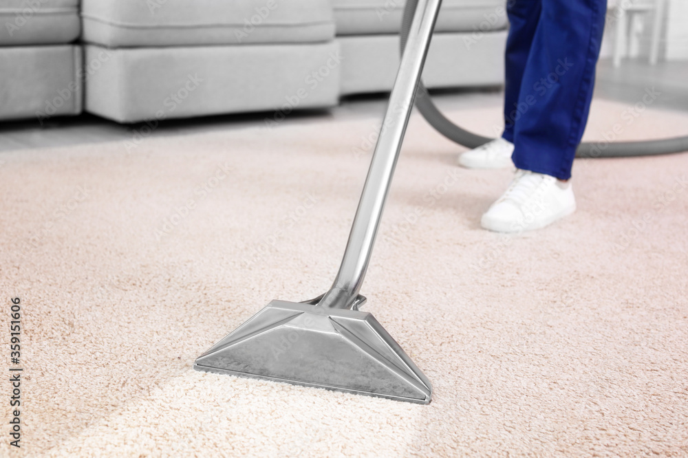 Fototapeta Worker removing dirt from carpet indoors, closeup. Cleaning service