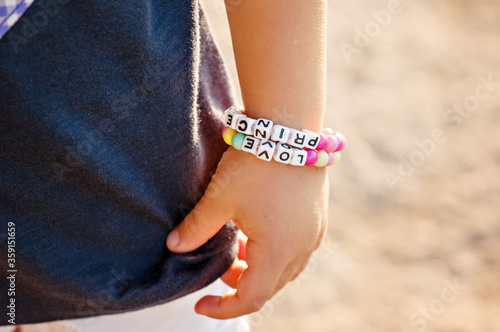 Fotografía DIY bracelet for children from square, round, colored beads with the words Love and Princess