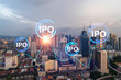 Hologram of IPO glowing icon, sunset panoramic city view of Kuala Lumpur. KL is the financial hub for transnational companies in Malaysia, Asia. The concept of boosting the growth by IPO process.