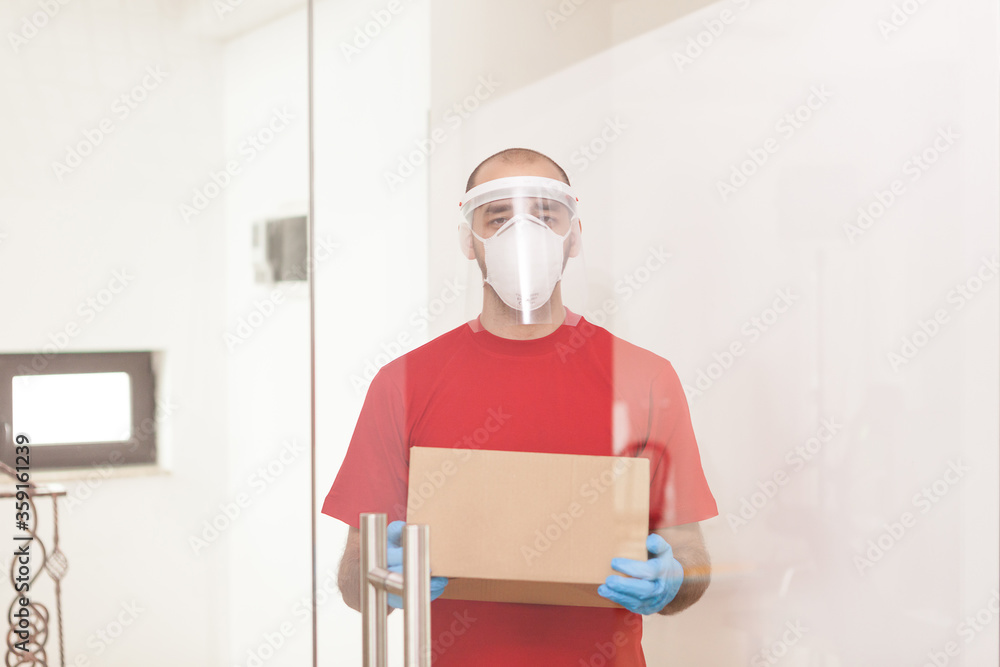 Fototapeta Man from delivery service wearing protection mask during coronavirus outbreak.