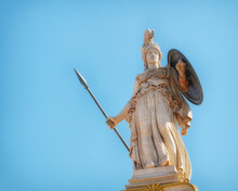 Athena Marble Statue With Helmet, Spear And Shield Under Clear Blue Sky, Athens Greece