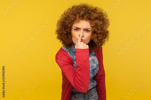 This is lie! Portrait of angry woman with fluffy curly hair touching nose, showing liar gesture, expressing distrust of false suggestion, deception Fototapet