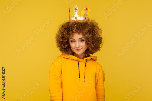 Valokuvatapetti I am queen! Lovely happy curly-haired hipster woman wearing crown on head and smiling, concept of self confidence in success, self-motivation and dreams to be best
