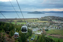 A Line Of Gondolas Going Up An...