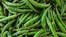 Pile Of Green Chili Pepper Bac...