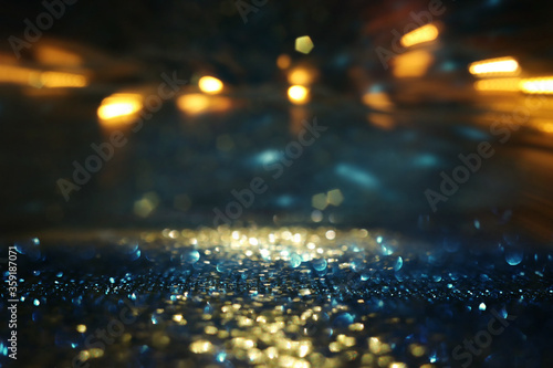 Obraz background of abstract glitter lights. gold, blue and black. de focused - fototapety do salonu