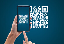 Hand Using Mobile Smart Phone Scan Qr Code On Blue Background. Cashless Technology And Digital Money Concept.
