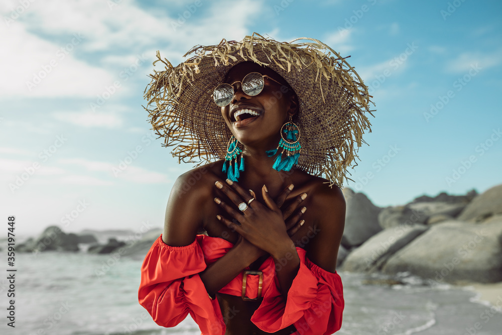 Fototapeta Beautiful african woman enjoying on the beach