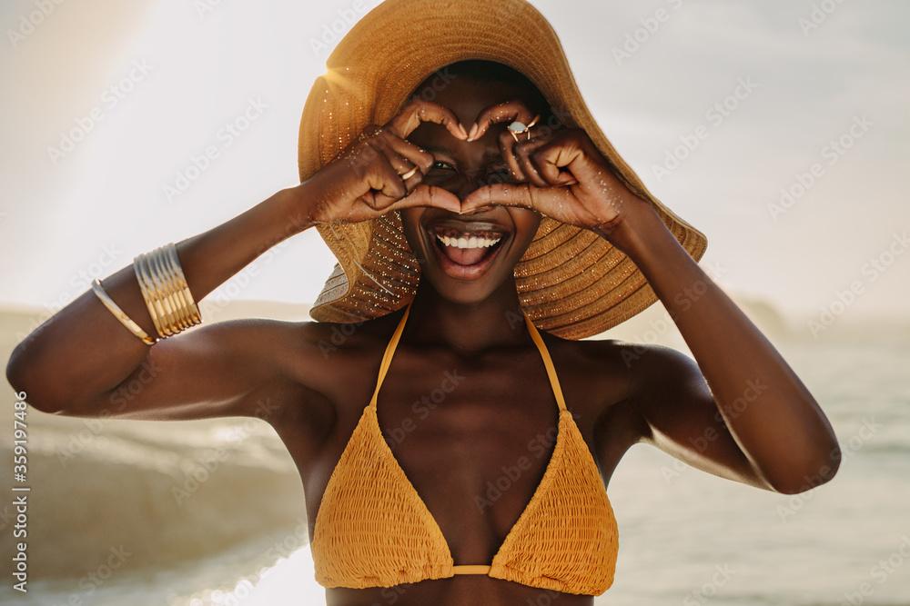 Fototapeta African woman on beach holiday