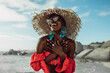 canvas print picture - Beautiful african woman enjoying on the beach