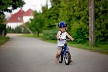 Child Riding Balance Bike