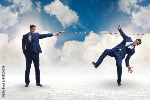 Cuadros en Lienzo Businessman with gun threatening his competitor