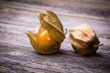 Physalis, Or Cape Gooseberry Fruit Over Old Wood Background. Vintage Effect.