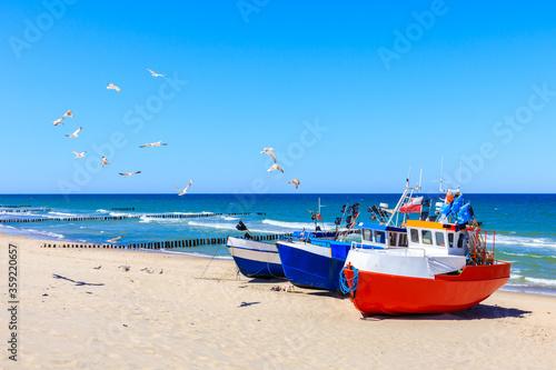 Obraz Fishing boats on sandy beach in Chlopy village port, Baltic Sea coast, Poland - fototapety do salonu